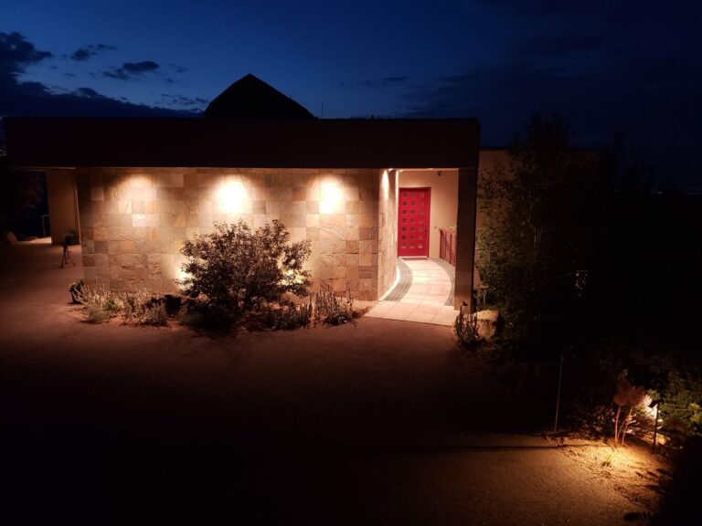 Lighted entranceway with a red door
