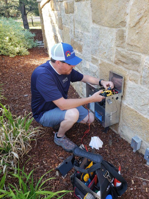 Man working on electrical box