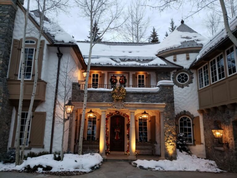 Beautiful white castle like house decorated for Christmas