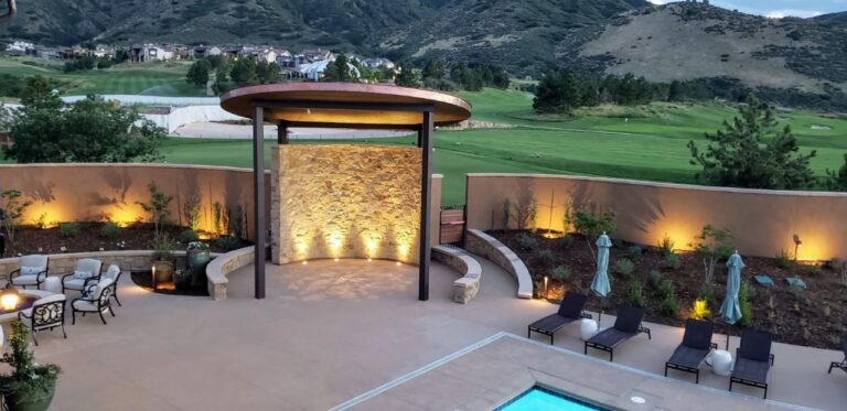 Covered lighted structure in a backyard with pool and firepit with golfcourse in background