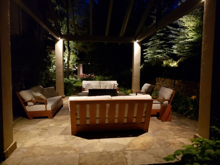 Lighted seating under a pergola