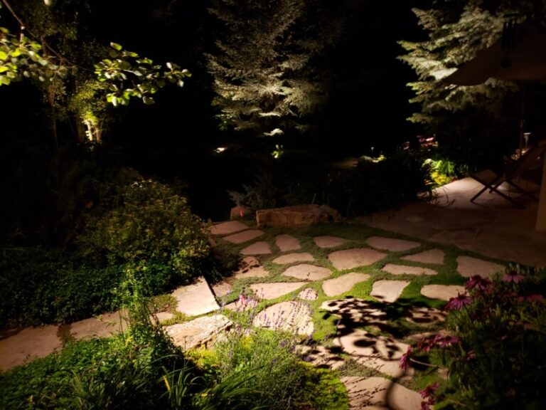Lighted stone pathway with grass