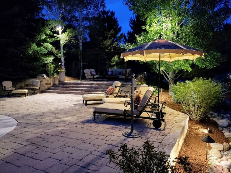 Corley pool with lounger chairs and umbrella
