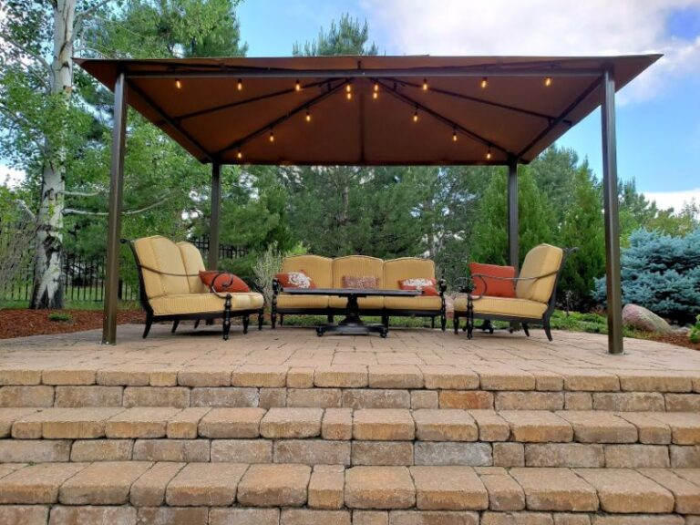 Yellow seating area under gazebo that is lighted