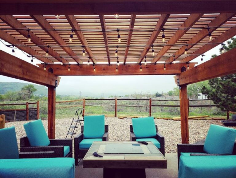 Seating area with turquoise cushions and pergola