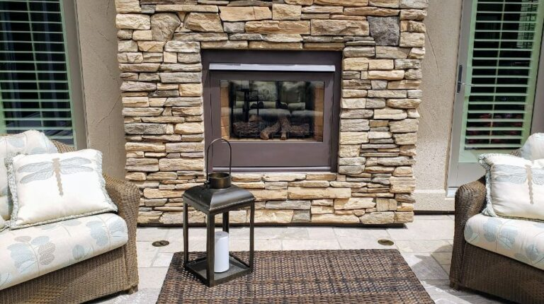 Stone fireplace with 2 sitting chairs