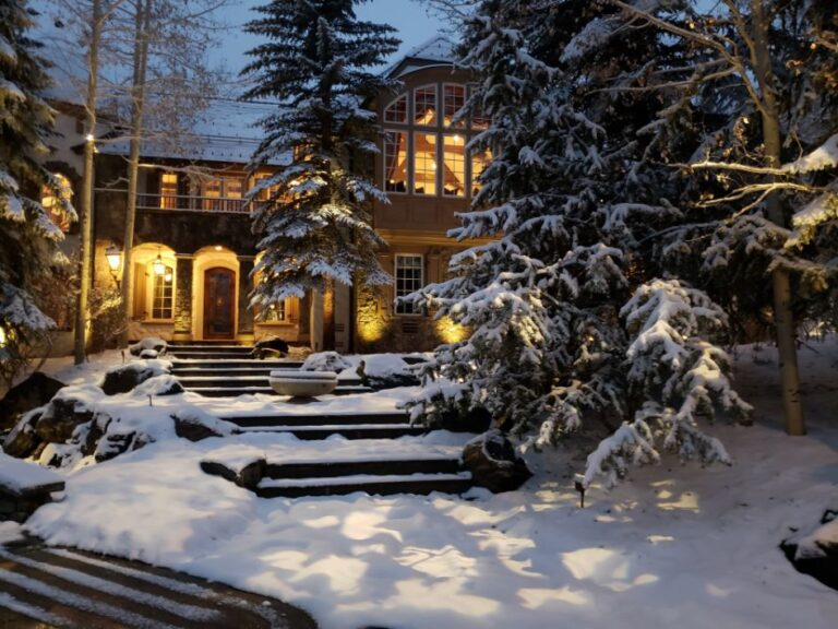 Snow covered house with steps